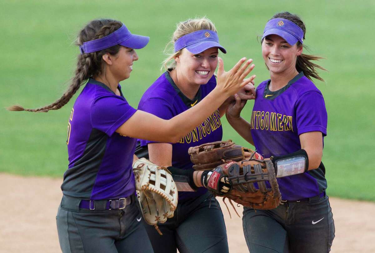 Montgomery center fielder Maggie Hendrix, right, gets a high-five from shortstop Gabby Moreno along with first baseman Alexa von Gontard after making a play on The Woodlands Alayis Seneca's fly ball during the fifth inning in Game 2 of a Region II-6A quarterfinal series Friday, May 12, 2017, in Huntsville.