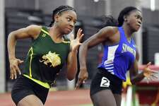 Hamden senior Aisha Gay finishes first in the 300 meter run in 39.56 at the CIAC Indoor Track & Field State Open, Saturday, Feb. 17, 2018, at Floyd Little Athletic Center at Hillhouse High School in New Haven. Simsbury senior Dinedye Denis placed third in 40.24.