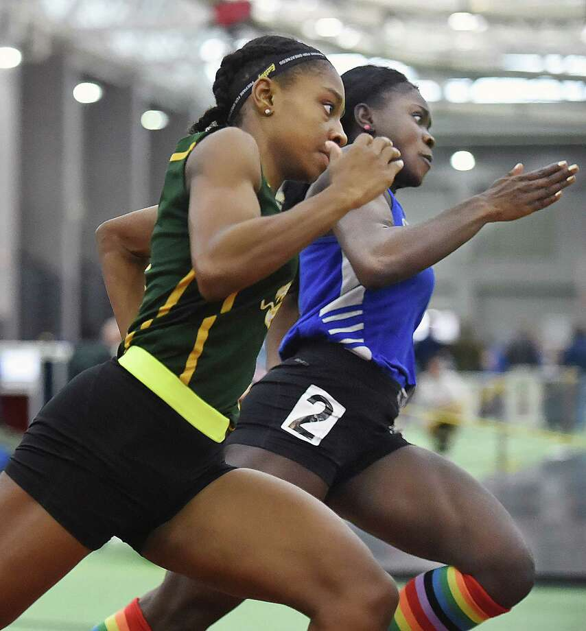Hamden senior Aisha Gay finishes first in the 300 meter run in 39.56 at the CIAC Indoor Track & Field State Open, Saturday, Feb. 17, 2018, at Floyd Little Athletic Center at Hillhouse High School in New Haven. Simsbury senior Dinedye Denis placed third in 40.24. Photo: Catherine Avalone, Hearst Connecticut Media / New Haven Register