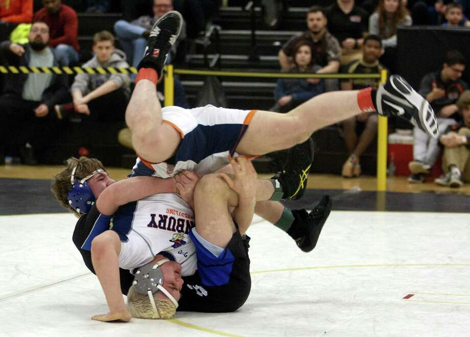 Danbury's Gino Baratta is turned over by Southington's Paul Calo during Class LL Wrestling Championship action in Trumbull, Conn. on Saturday Feb. 17, 2018. Photo: Christian Abraham / Hearst Connecticut Media / Connecticut Post