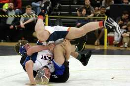 Danbury's Gino Baratta is turned over by Southington's Paul Calo during Class LL Wrestling Championship action in Trumbull, Conn. on Saturday Feb. 17, 2018.