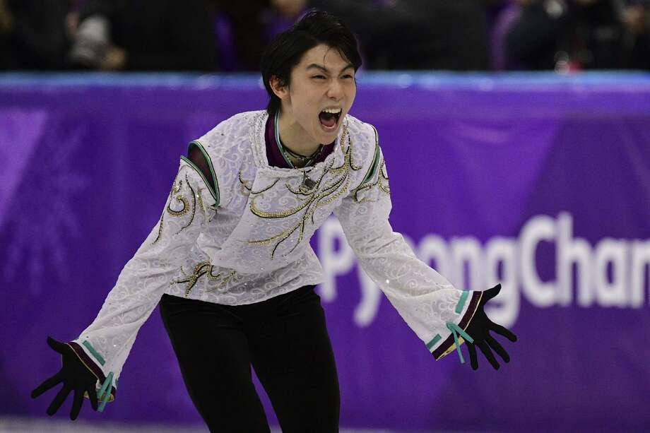 Japan's Yuzuru Hanyu is beyond excited Saturday at becoming the first repeat Olympic champion in men's skating since American Dick Button 66 years ago. Photo: ROBERTO SCHMIDT, Contributor / AFP or licensors