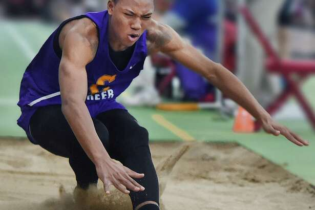 Career's Dyshon Vaughn won the long jump with a distance of 23 feet, 8.5 inches at the boys indoor track and field State Open Saturday in New Haven.