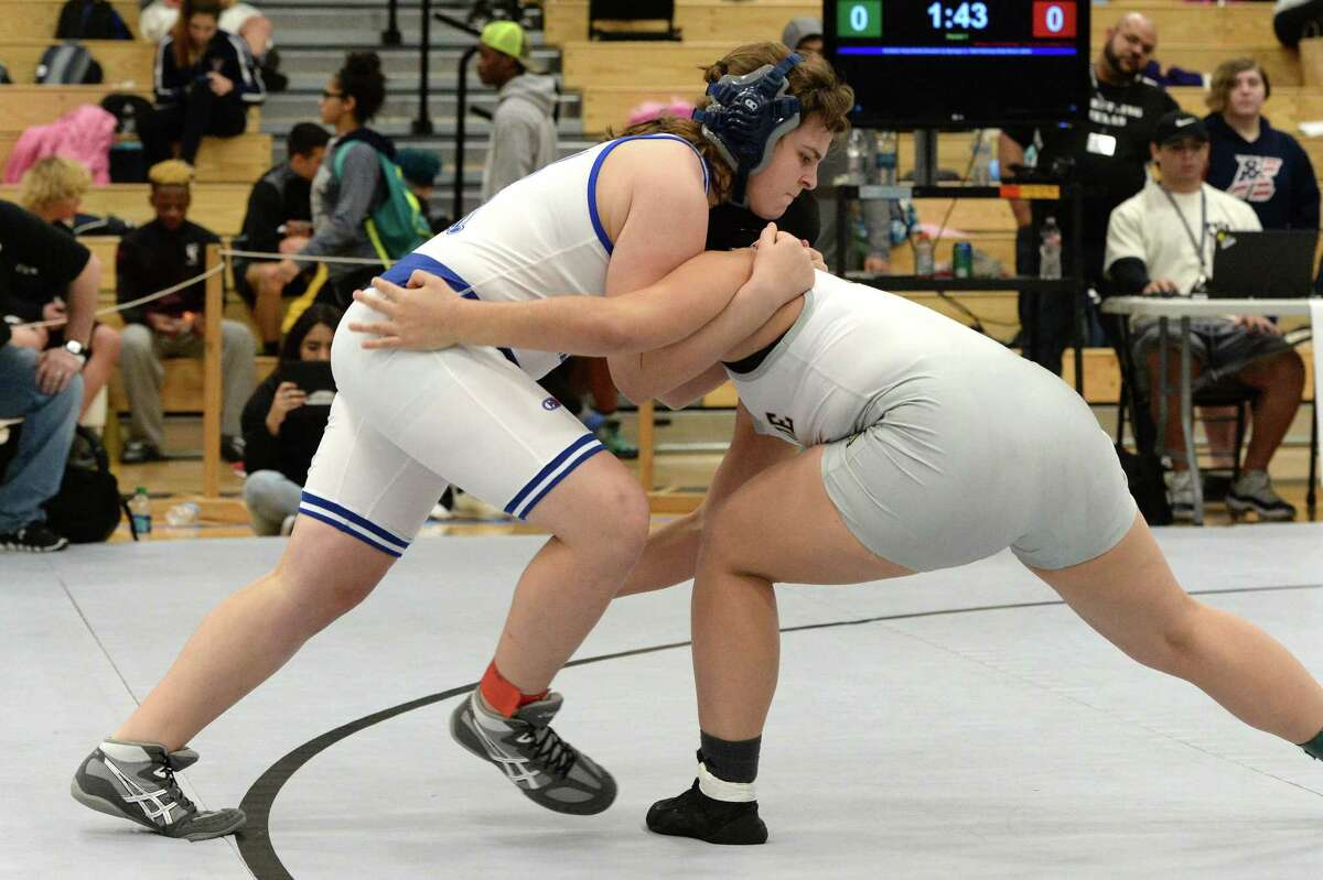 Brittyn Corbishley of College Park competes against Lessly Sandoval of Conroe in the girls 185 pound weight class during the girls Region III 6-A UIL Wrestling Championships on Saturday February 17, 2018 at Paetow HS, Katy, TX.