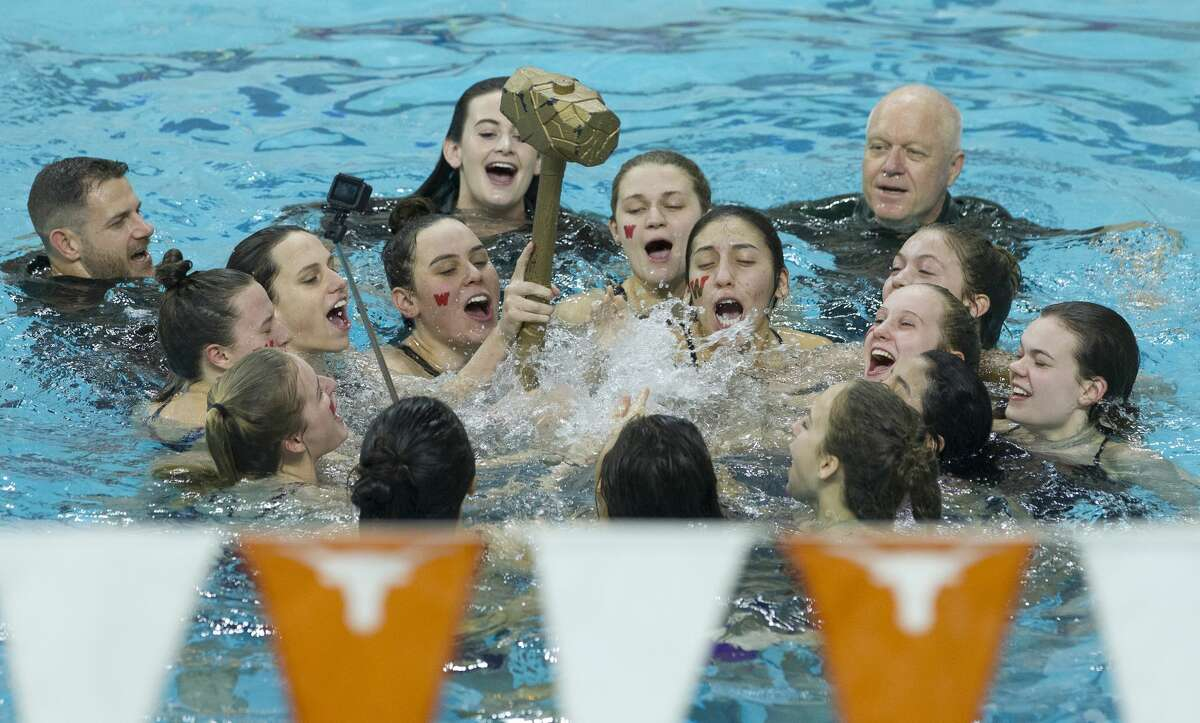 The Woodlands girls team celebrates after defending their team title during the Class 6A UIL State Swimming & Diving Championships at the Lee and Joe Jamail Texas Swim Center on Saturday, Feb. 17, 2018, in Austin.
