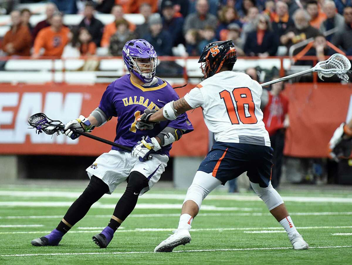 UAlbany freshman Tehoka Nanticoke looks for an opening against Syracuse's Tyson Bomberry during their game Saturday, Feb. 17, 2018, at the Carrier Dome in Syracuse. (Greg Wall / UAlbany Athletics)
