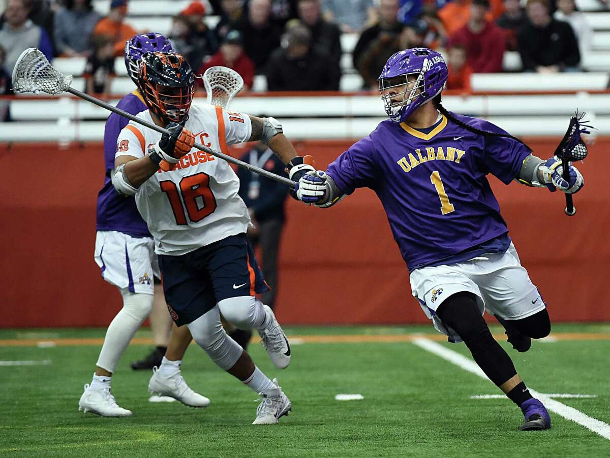 UAlbany freshman Tehoka Nanticoke, right, makes a move past Tyson Bomberry of Syracuse during their game Saturday, Feb. 17, 2018, at the Carrier Dome in Syracuse. (Greg Wall / UAlbany Athletics)