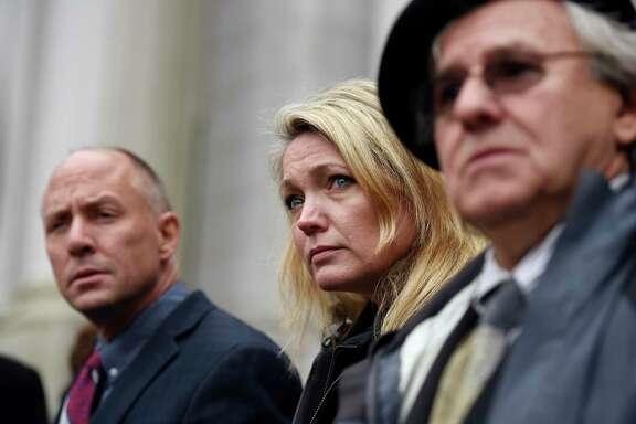 Mark Barden, from left, Nicole Hockley and Gilles Rousseau, the parents of Sandy Hook Elementary School shooting victims, met with state lawmakers as they debated gun-control legislation. For them, some measures still fell short.
