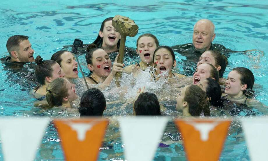 The Woodlands girls team celebrates after defending their team title during the Class 6A UIL State Swimming & Diving Championships at the Lee and Joe Jamail Texas Swim Center on Saturday, Feb. 17, 2018, in Austin. Photo: Jason Fochtman, Staff Photographer / © 2018 Houston Chronicle