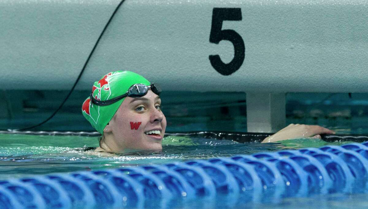 Lucie Norman of The Woodlands smiles after winning the Class 6A girls 100-yard backstroke during the Class 6A UIL State Swimming & Diving Championships at the Lee and Joe Jamail Texas Swim Center on Saturday, Feb. 17, 2018, in Austin.