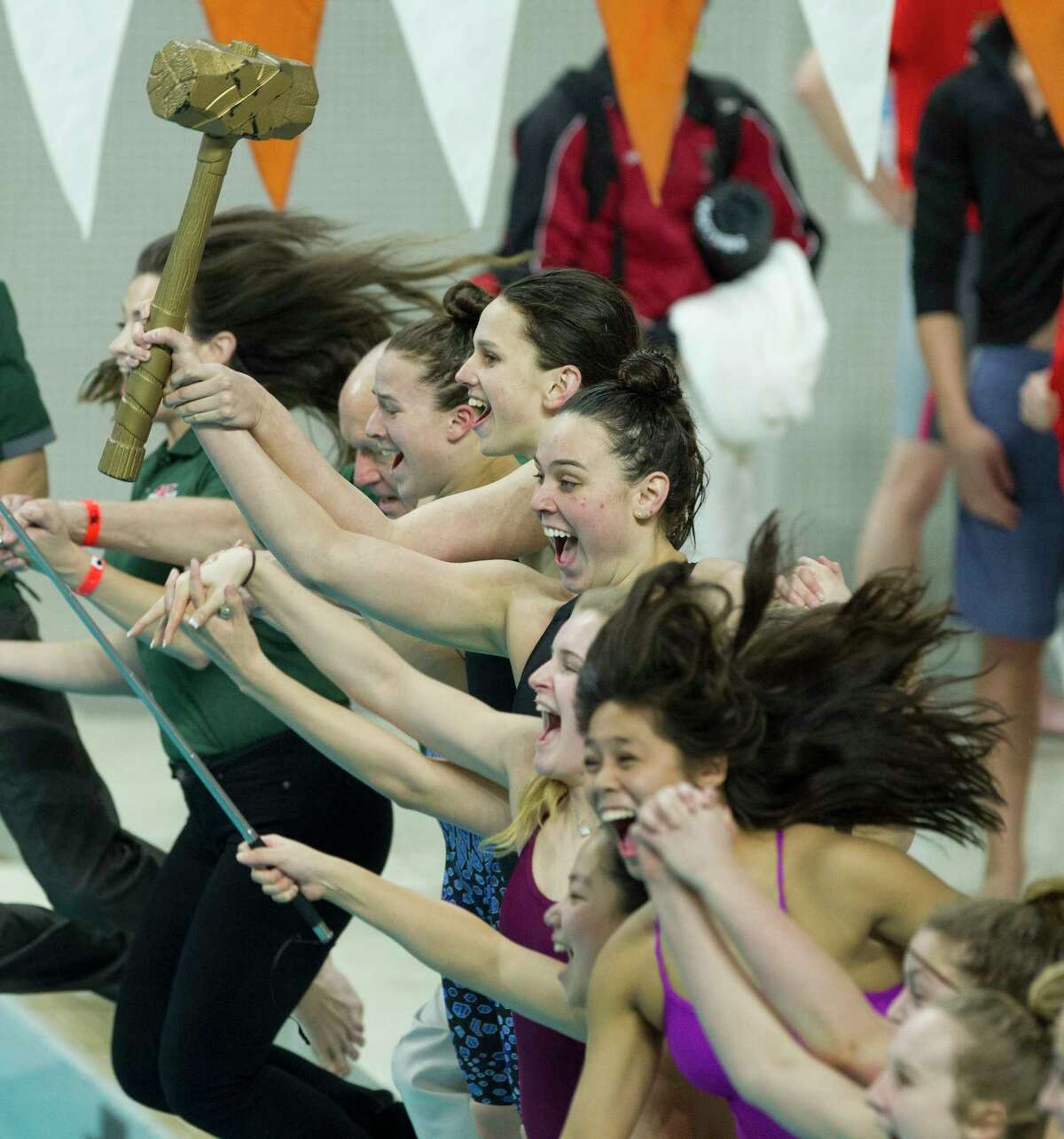 The Woodlands girls team celebrates defending their overall state title during the Class 6A UIL State Swimming & Diving Championships at the Lee and Joe Jamail Texas Swim Center on Saturday, Feb. 17, 2018, in Austin.