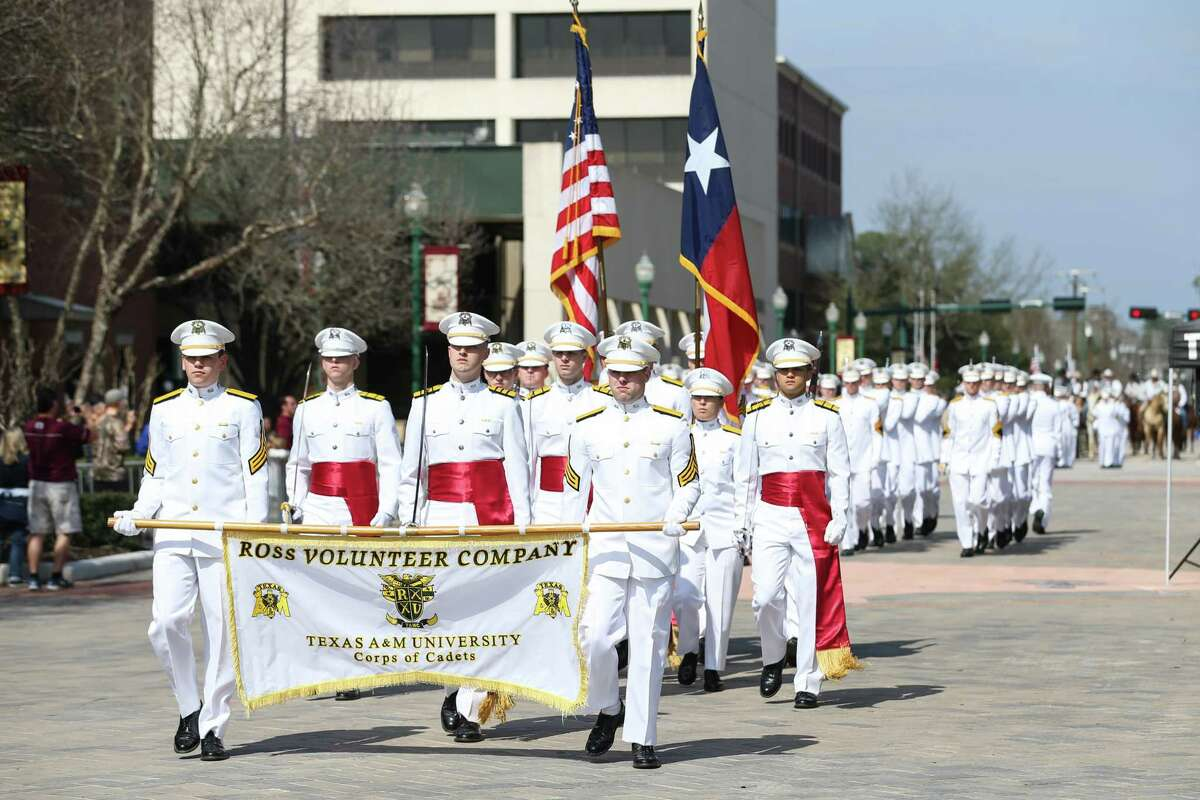 The Ross Volunteer Company of the Texas A&M Corps of Cadets march in the 53rd annual Go Texan Parade and Stampede on Saturday, Feb. 17, 2018, in downtown Conroe.