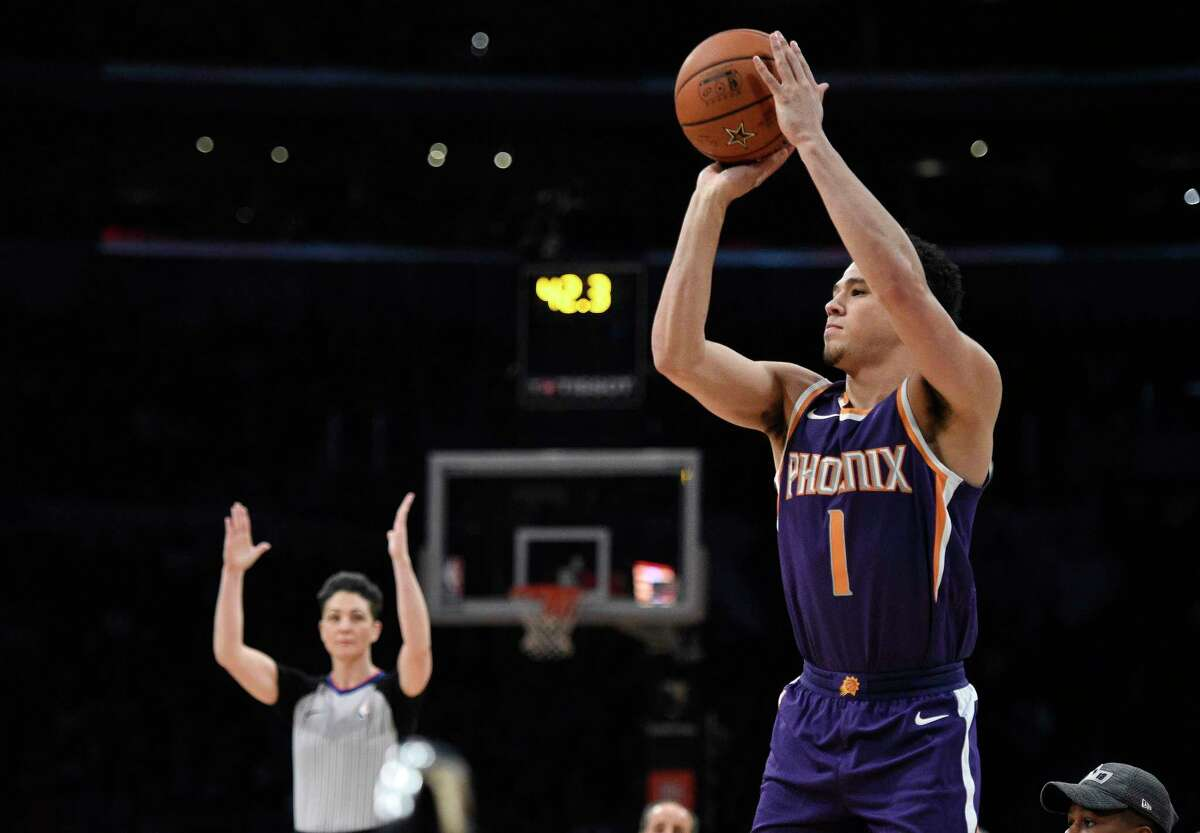 Phoenix Suns' Devin Booker shoots during the NBA basketball All-Star weekend 3-Point contest, Saturday, Feb. 17, 2018, in Los Angeles. Booker won the event. (AP Photo/Chris Pizzello)