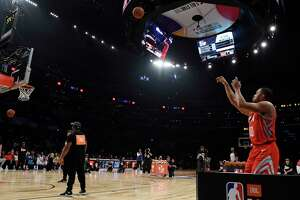 Houston Rockets' Eric Gordon shoots during the NBA All-Star basketball Three Point contest, Saturday, Feb. 17, 2018, in Los Angeles. (AP Photo/Chris Pizzello)