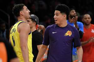 Phoenix Suns' Devin Booker, right, is congratulated by Golden State Warriors' Klay Thompson after winning the NBA All-Star basketball 3-Point contest, Saturday, Feb. 17, 2018, in Los Angeles. (AP Photo/Chris Pizzello)