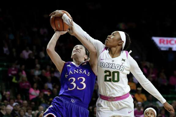 Kansas guard Kylee Kopatich (33) is fit to be denied as Baylor guard Juicy Landrum blocks her shot in the first half Saturday.