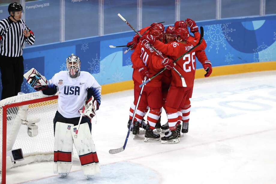 Olympic Athletes from Russia celebrate after scoring a goal in the first period against the United States during the Men's Ice Hockey Preliminary Round Group B game on February 17, 2018, at the PyeongChang 2018 Winter Olympic Games. Things have gotten so bad that the U.S. men's hockey team has taken to fist bumps rather than the more traditional handshake with opponents. Photo: Ronald Martinez, Staff / 2018 Getty Images