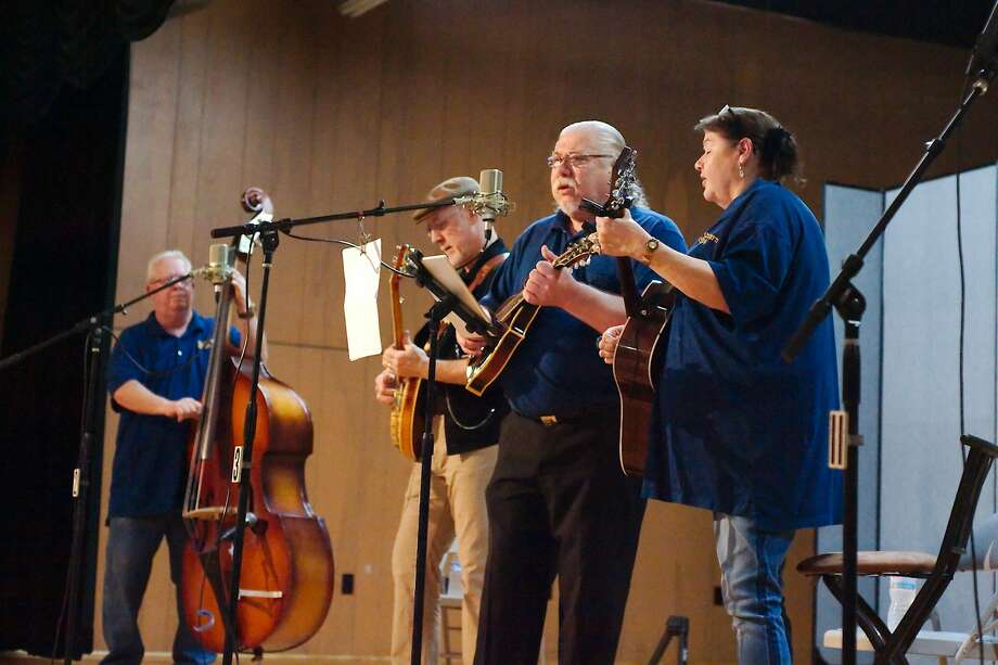 Bass player Roger Eklund, banjo player Greg English, mandolin player Rick Kirkland and guitar player Pauline Eklund perform with bluegrass band Southern Style during the Bay Area Bluegrass Association monthly show at the Johnny Arolfo Civic Center in League city, Saturday, Feb. 17. Photo: Kirk Sides / Houston Chronicle