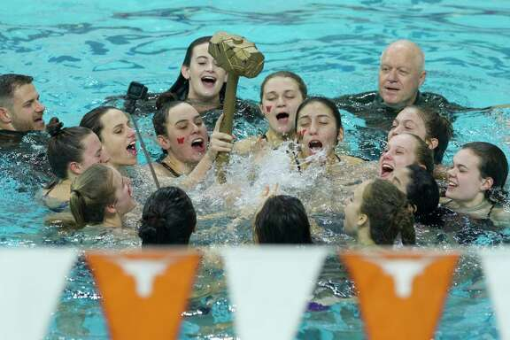 The Woodlands girls team celebrates after defending their team title at the Class 6A state swimming and diving in Austin.