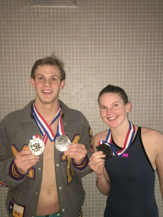 Midland High senior swimmers Braden Vines and Mollie Wright, left, pose with their medals after reaching the podium at Saturday's UIL Class 6A State Swimming and Diving Championships in Austin. Vines won the boys 100 breaststroke and placed second in the 200 IM, while Wright finished second in the girls 500 freestyle. Courtesy photo