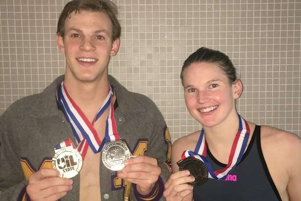 Midland High senior swimmers Braden Vines and Mollie Wright, right, pose with their medals after reaching the podium at Saturday's UIL Class 6A State Swimming and Diving Championships in Austin. Vines won the boys 100 breaststroke and placed second in the 200 IM, while Wright finished second in the girls 500 freestyle. Courtesy photo