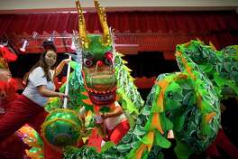 Members of the Shaolin Temple Cultural Center dance during a Lunar New Year celebration at the Chinese Community Center in southwest Houston on Saturday.