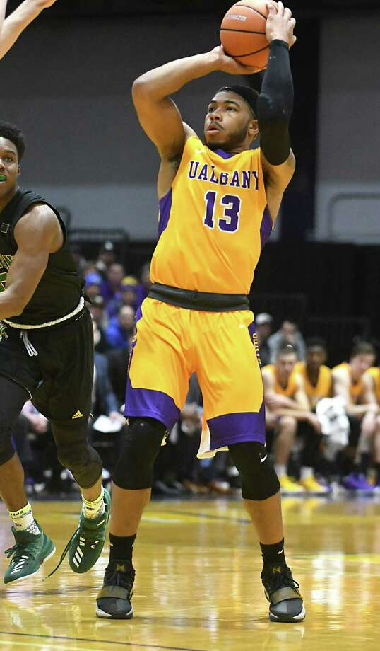 University at Albany's David Nichols makes a jump shot during a basketball game against Vermont at SEFCU Arena on Thursday, Feb. 8, 2018 in Albany, N.Y. (Lori Van Buren/Times Union) Photo: Lori Van Buren / 0042387A