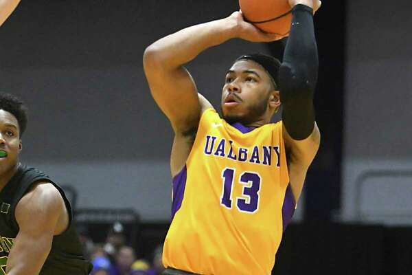 University at Albany's David Nichols makes a jump shot during a basketball game against Vermont at SEFCU Arena on Thursday, Feb. 8, 2018 in Albany, N.Y. (Lori Van Buren/Times Union)