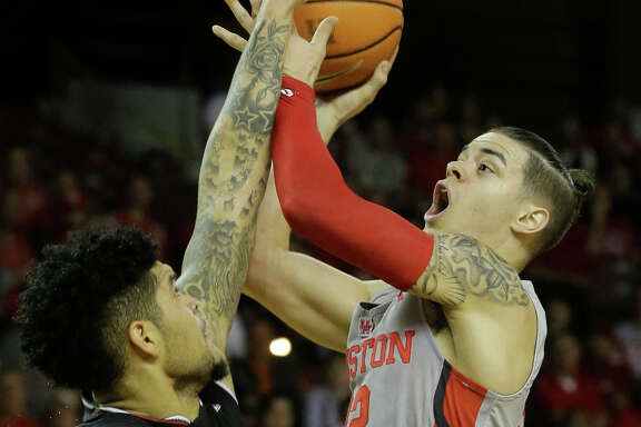 University of Cincinnati Jarron Cumberland, left, looks to block the shot of University of Houston Rob Gray during the first half of game at Texas Southern University Thursday, Feb. 15, 2018, in Houston. ( Melissa Phillip / Houston Chronicle )