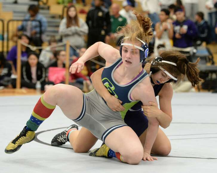 Hunter Robinson of College Park and Jordan Suarez of Morton Ranch compete in the girls 138 pound weight class during the girls Region III 6-A UIL Wrestling Championships on Saturday February 17, 2018 at Paetow HS, Katy, TX.