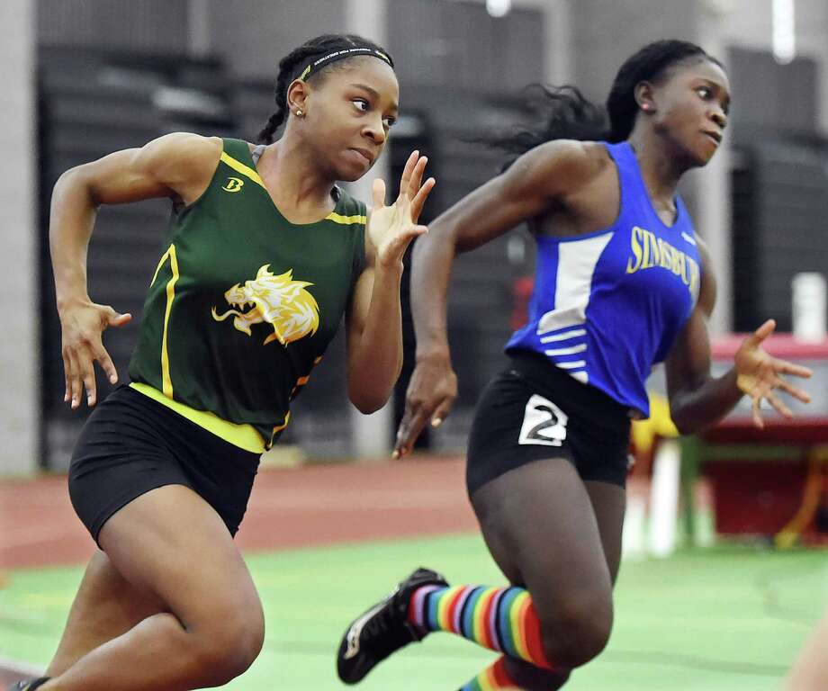 Hamden senior Aisha Gay, left, won the 300 meters at Saturday's girls indoor track and field State Open in New Haven. Photo: Catherine Avalone / Hearst Connecticut Media / New Haven Register