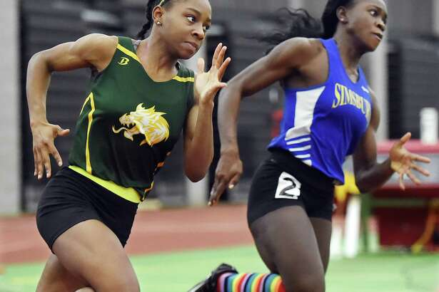 Hamden senior Aisha Gay, left, won the 300 meters at Saturday's girls indoor track and field State Open in New Haven.
