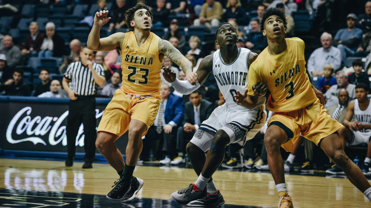Monmouth's Ray Salnave battled for position with Siena's Jordan Horn (23) and Manny Camper earlier this season in a game the Hawks won 67-56. (Karlee Sell/Monmouth athletics)