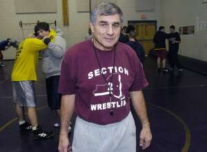 Times Union Photo by James Goolsby     Dec. 8, 2005-Coach Joe Bena, head coach of the Duanesburg H.S. Wrestling Team. Hopes to go for the N.Y.S. record for coaching victories.  Coach Bena has 463 victories in 40 years to his credit, the record is 465.The coach hopes to getthe victories on saturday.