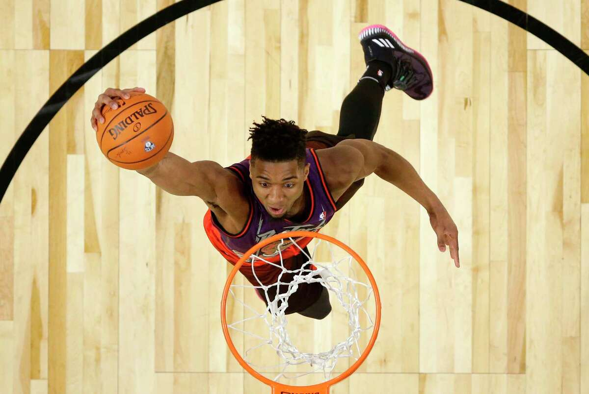 Utah Jazz's Donovan Mitchell competes in the NBA basketball All-Star weekend slam dunk contest Saturday, Feb. 17, 2018, in Los Angeles. Mitchell won the event. (Bob Donnan/Pool via AP)