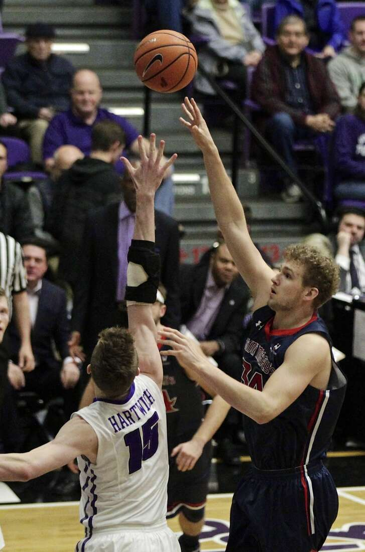 Saint Mary's center Jock Landale, right, shoots over Portland center Philipp Hartwich during the first half of an NCAA college basketball game in Portland, Ore., Saturday, Feb. 17, 2018. (AP Photo/Steve Dipaola)