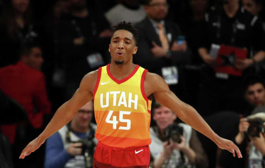 230db55129d Utah s Donovan Mitchell reacts to his first dunk in the NBA All Star  Saturday Night Slam