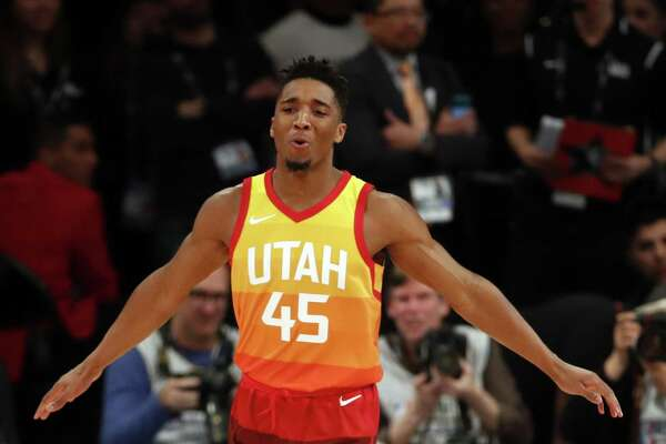 Utah's Donovan Mitchell reacts to his first dunk in the NBA All Star Saturday Night Slam Dunk competition at Staples Center in Los Angeles, Calif., on Saturday, February 17, 2018.