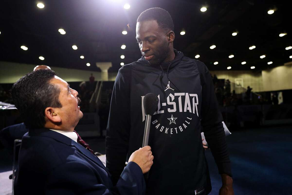 Golden State Warriors' Draymond Green is asked a question by Jimmy Kimmel Live's Guillermo Rodriguez.