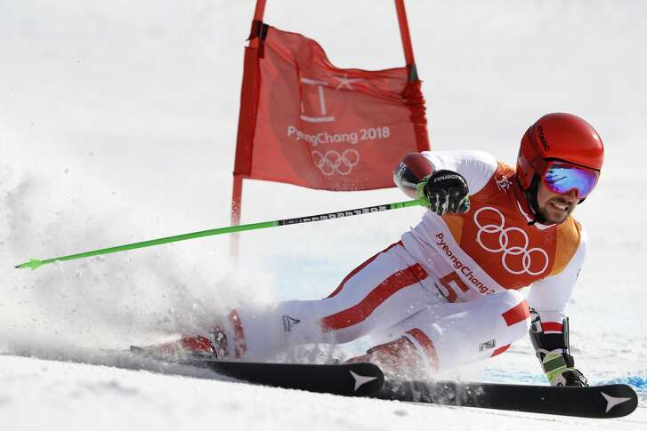 Austria's Marcel Hirscher skis to the gold medal in the second run of the men's giant slalom at the 2018 Winter Olympics in Pyeongchang, South Korea, Sunday, Feb. 18, 2018. (AP Photo/Luca Bruno)
