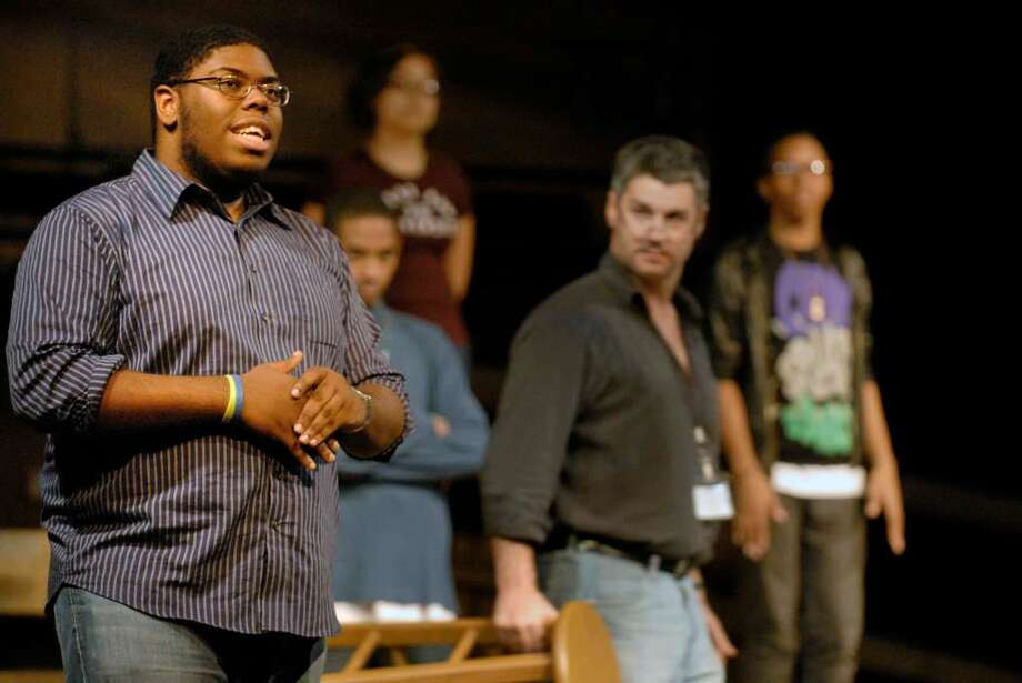Student Aaron Moore, left, recites his lines during a rehearsal of the Albany High School production of  the Laramie Project in Albany, New York 11/10/2009. Photo: MICHAEL P. FARRELL / 00006343A