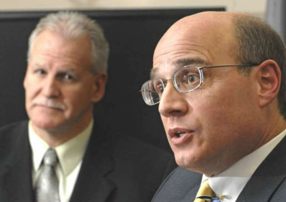 Acting U.S. Attorny Andrew T. Baxter answers questions from Times Union reporters during an exclusive meeting at the Federal Courthouse in Albany , NY on December 10, 2009. John Pikus, FBI's special agent in charge of Albany, listens next to him.  (Lori Van Buren / Times Union)