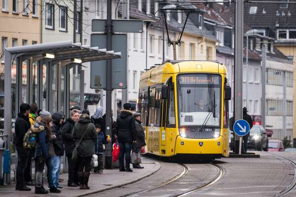 ESSEN, GERMANY - FEBRUARY 15: An electric tram drives through the city center on February 15, 2018 in Essen, Germany. Essen is one of five cities that will possibly introduce free public transport as an experiment to encourage people to leave their cars at home and therefore reducing air pollution. Germany is under pressure from the European Union to meet clean air standards in its cities, as too many cities in Germany are falling short, mainly due to pollution from cars. (Photo by Lukas Schulze/Getty Images)
