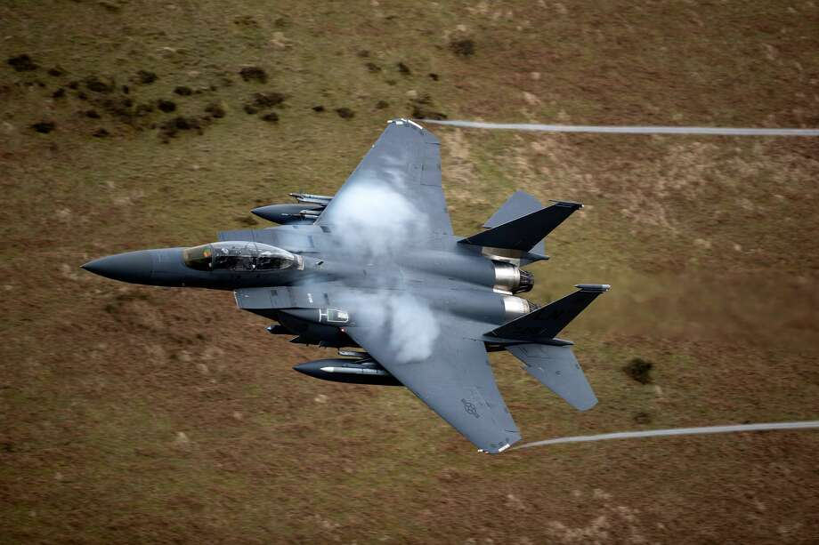DOLGELLAU, WALES - A United States Air Force F-15 fighter jet based at RAF Lakenheath speeds through the Dinas Pass, known in the aviation world as the Mach Loop on February 16, 2018 in Dolgellau, Wales. Photo: Christopher Furlong/Getty Images