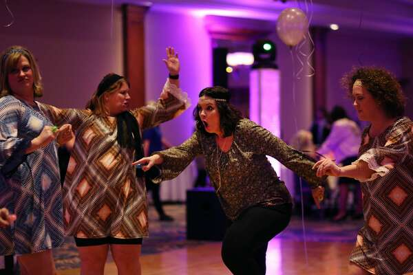 Participants dance during Mom Prom at the Great Hall Banquet & Convention Center in Midland on Saturday, Feb 17, 2018. (Samantha Madar/for the Daily News)