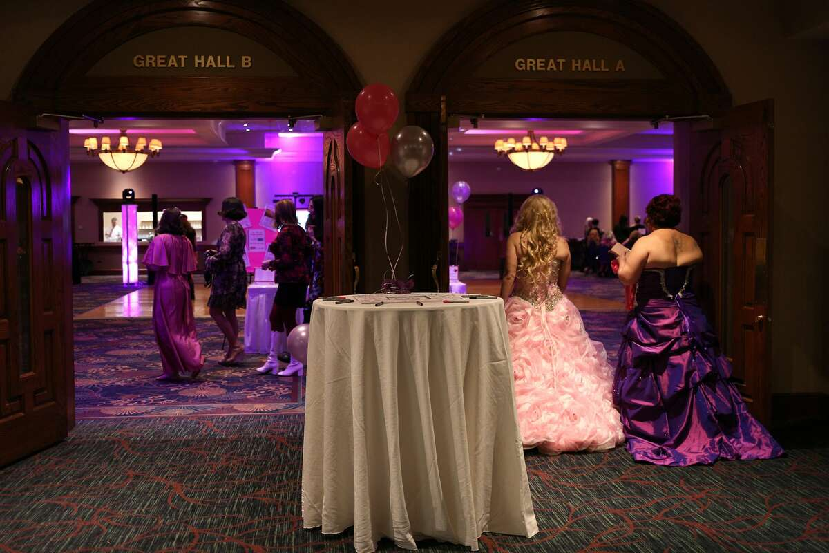 Participants enter Mom Prom at the Great Hall Banquet & Convention Center in Midland on Saturday, Feb 17, 2018. (Samantha Madar/for the Daily News)