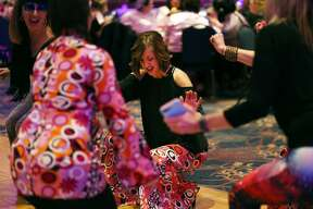 Kari Back of Freeland dances with friends during Mom Prom at the Great Hall Banquet & Convention Center on Saturday. (Samantha Madar/for the Daily News)