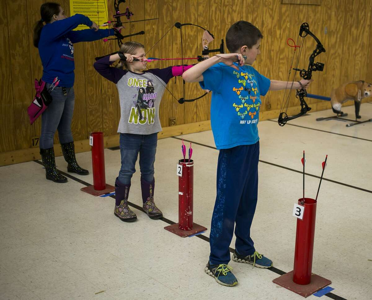 Young archers aim during the Youth Indoor 3D shoot at Mid Michee Bowmen Saturday, Feb. 17, 2018. (Josie Norris/for the Daily News)