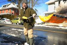 Joe DiMartino shovels wet snow from in front of the garage and walkway outside his residence on Shelton Avenue in Sheton, Conn. on Sunday, February 18, 2018.