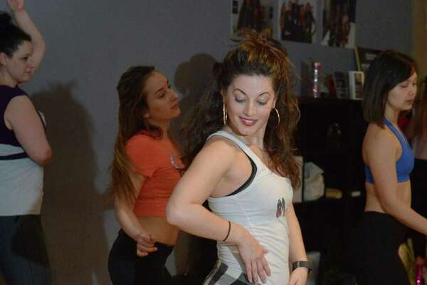 Caitlin Elby teaches the a fitness class she developed, Hell on Heels, that helps women walk and move correctly in high heels at Move It! Fitness in Norwalk on Saturday.